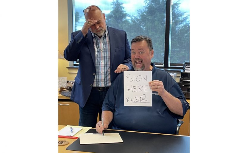Big Jim signs his contract with Mac Edwards